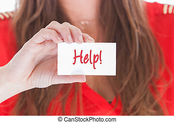 Woman in red showing a business card