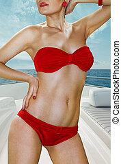 woman in red underwear on yacht