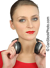 Woman in red with a pair of headphones