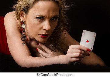 Woman in red with playing card