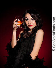 woman in retro dress with cognac