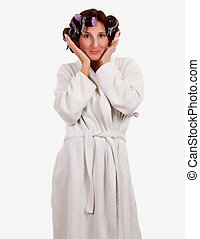 Woman in rollers - Brunette woman with hair in rollers...
