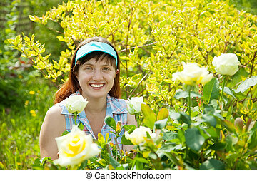 woman in rose plant