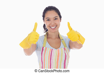 Woman in rubber gloves giving thumbs up