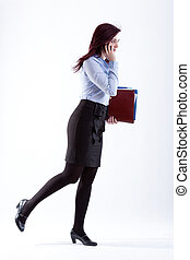 Woman in rush. - Woman running to the work with briefcase.