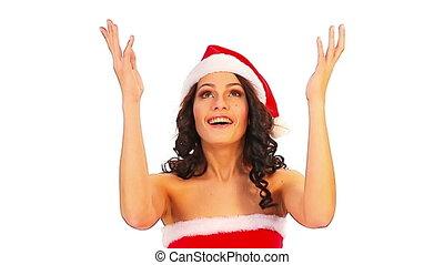 Woman in Santa hat catch falling money dollar. Isolated.