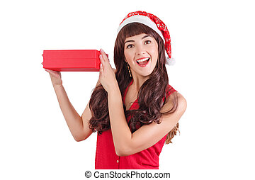 Woman in santa hat holding Christmas gift box isolated on white with copyspace. Happy exited girl unpacking her present