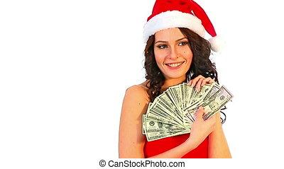 Woman in Santa hat holding money dollar. - Woman in Santa...