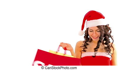 Woman in Santa hat holding shopping bag. Isolated.