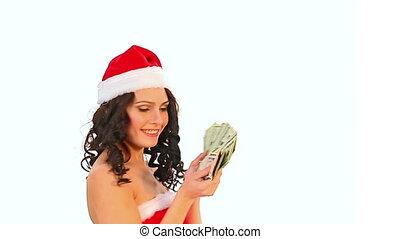 Woman in Santa hat keeps money dollar. Isolated.