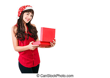 Woman in santa hat opening Christmas gift box isolated on white with copyspace. Happy girl unpacking her present