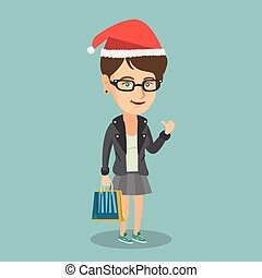Woman in santa hat shopping for christmas gifts.