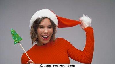 woman in santa helper hat having fun on christmas