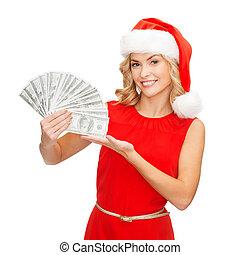 woman in santa helper hat with us dollar money - christmas,...