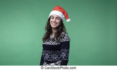 woman in santa's cap showing thumb up and smiling