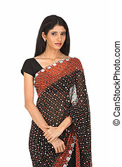 woman in sari standing peacefully
