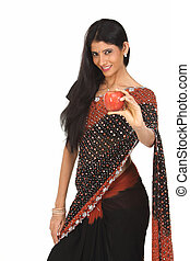 Woman in sari with red apple