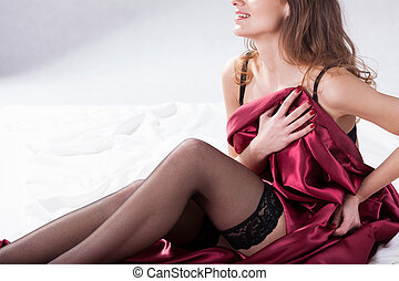 Woman in satin bedding - Sexy woman in satin bedding on bed