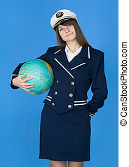 Woman in sea uniform with globe