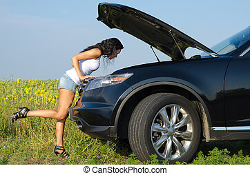 Woman in sexy shorts checking engine - Woman in sexy shorts...