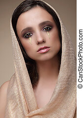 Woman in Shawl with Dramatic Stagy Makeup