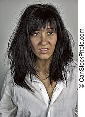 woman in shock with massy hair