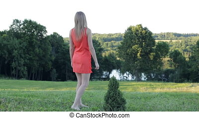 Woman in short red dress