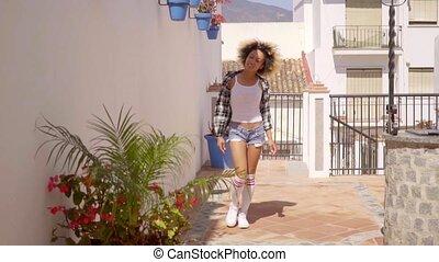 Woman in Shorts and Knee Socks Walking in Sunshine - Full...