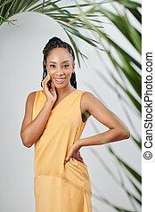 Woman in silk yellow dress