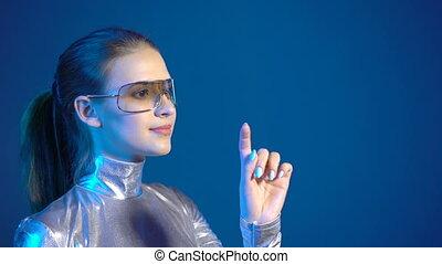 Woman in silver clothing wearing eyeglasses pressing virtual...