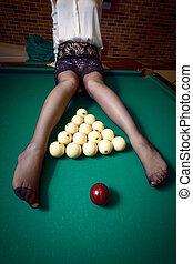 woman in sitting on billiard table