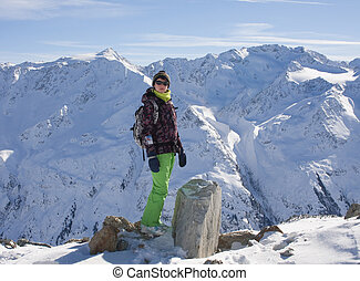 woman in ski cloths and the snowy mountains, austria