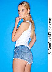 Woman in Sleeveless Shirt and Denim Mini Shorts