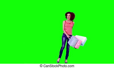 Woman in slow motion holding shopping bags