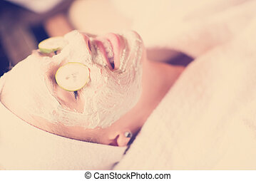 woman in spa  with cosmetic mask
