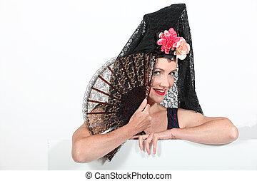 Woman in Spanish senora costume