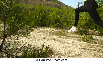 woman in sports uniform practicing run outdoors