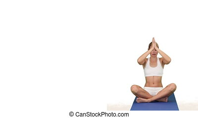 Woman in sportswear doing yoga