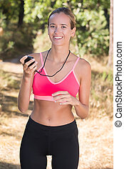 Woman in sportswear holding stopwatch