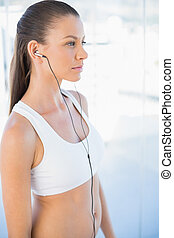Woman in sportswear listening to music