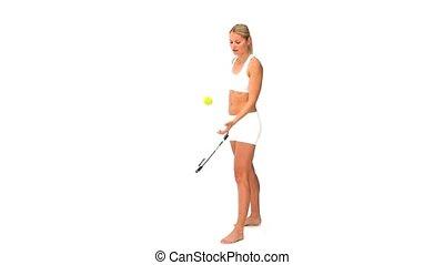 Woman in sportswear playing tennis