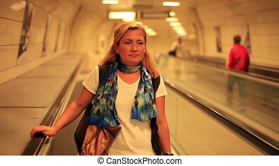 woman in station - women going to the metro station, steady...
