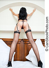 Woman in stockings with sexy ass and legs