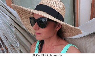 Woman in straw hat enjoy the summer