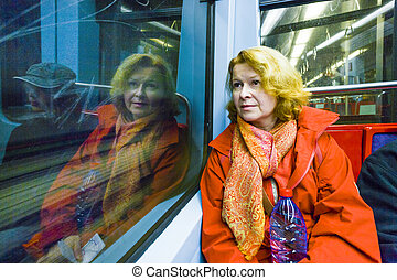 woman in subway by night