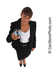 Woman in suit holding glass of water