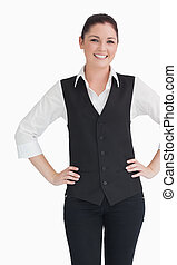 Woman in suit standing against the white background -...