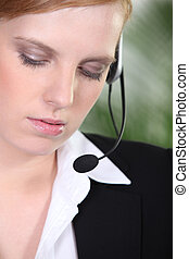 Woman in suit with headset