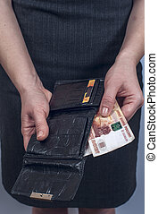 Woman in suit with leather purse full of money - Woman in...