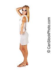 woman in summer mini dress and sunglasses